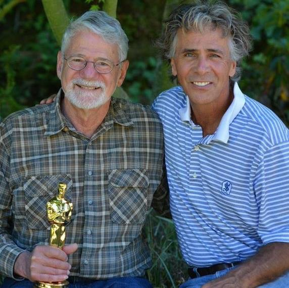 Photograph of Barrie Osborne and Jim Jarrett with Barrie's Oscar